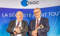Guy Tardieu takes over from Jean-Marc de Raffin Dourny at the controls of OSAC
