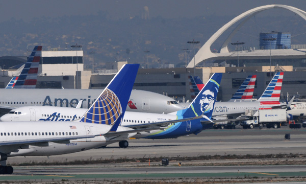 Pelosi urges US airlines to stop layoffs, backs aid